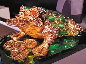 Зеленая трехлапая жаба